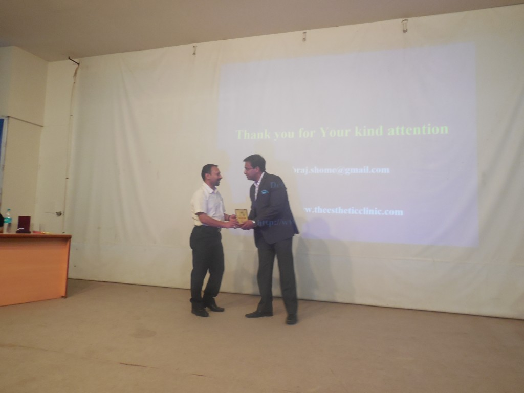 "Dr. Debraj Shome being felicitated at the plastic surgery meeting,Pune, June 2015, post his talk on the ""The aging face and the mid-face lift""."